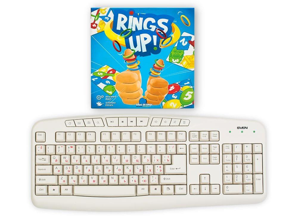 Коробка настольной игры Разноцветные колечки (Rings Up) в сравнении с клавиатурой