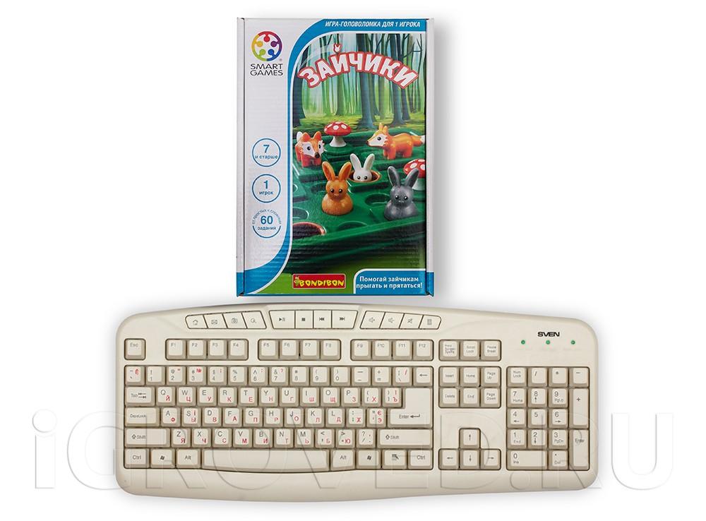Коробка настольной игры Зайчики в сравнении с клавиатурой