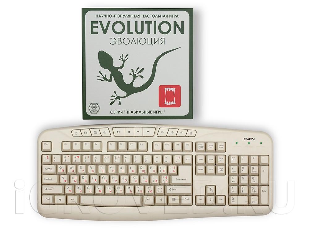 Коробка с настольной игрой Эволюция по сравнению с клавиатурой