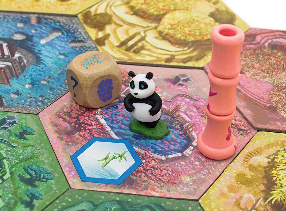 Панда очень любит есть бамбук в настольной игре Такеноко