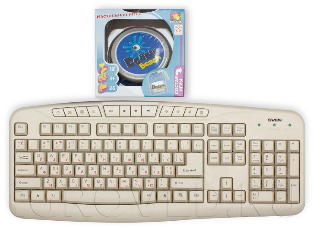 Коробка настольной игры Доббль Пляж по сравнению с клавиатурой