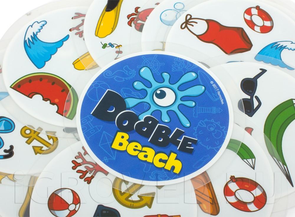Плотные пластиковые карточки выдержат испытание водой и песком. Настольная игра Доббль Пляж
