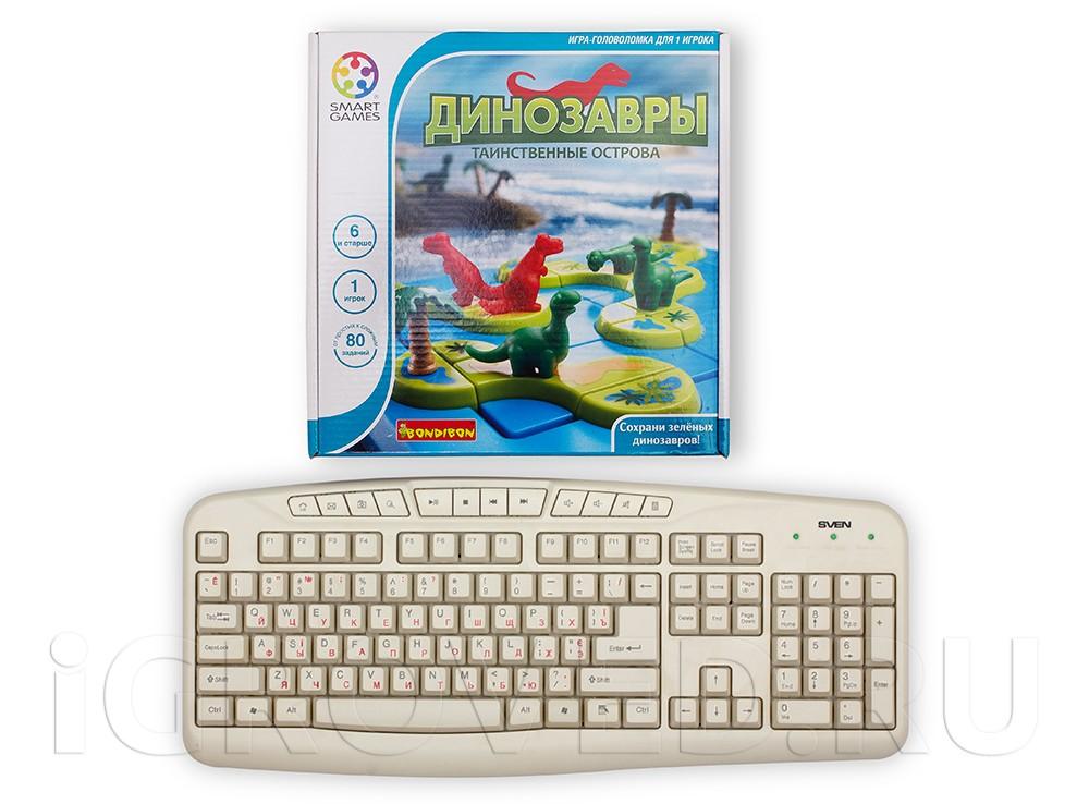 Коробка настольной игры Динозавры. Таинственные острова в сравнении с клавиатурой