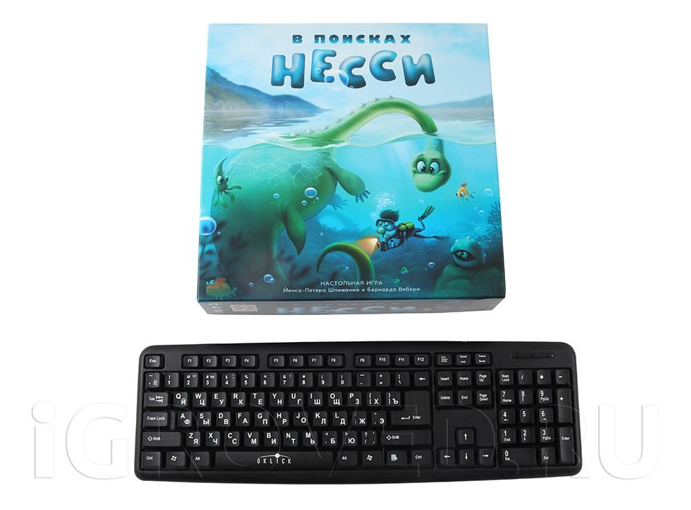 Коробка настольной игры В поисках Несси в сравнении с клавиатурой