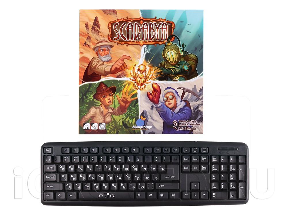 Коробка настольной игры Скарабеи (Scarabya) в сравнении с клавиатурой