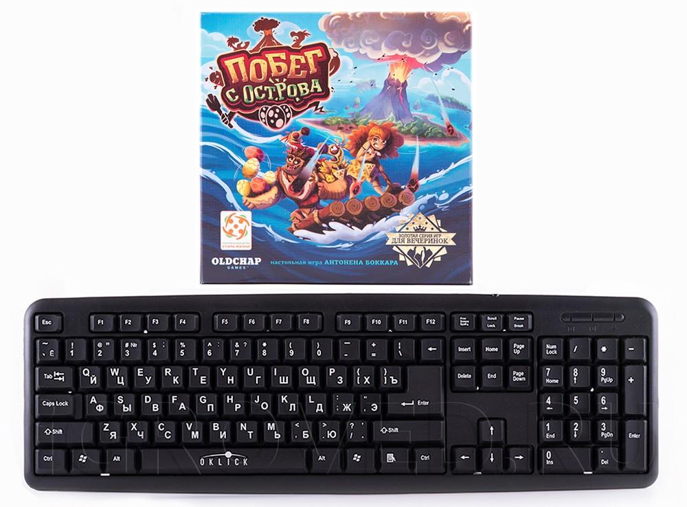 Коробка настольной игры Побег с острова по сравнению с клавиатурой
