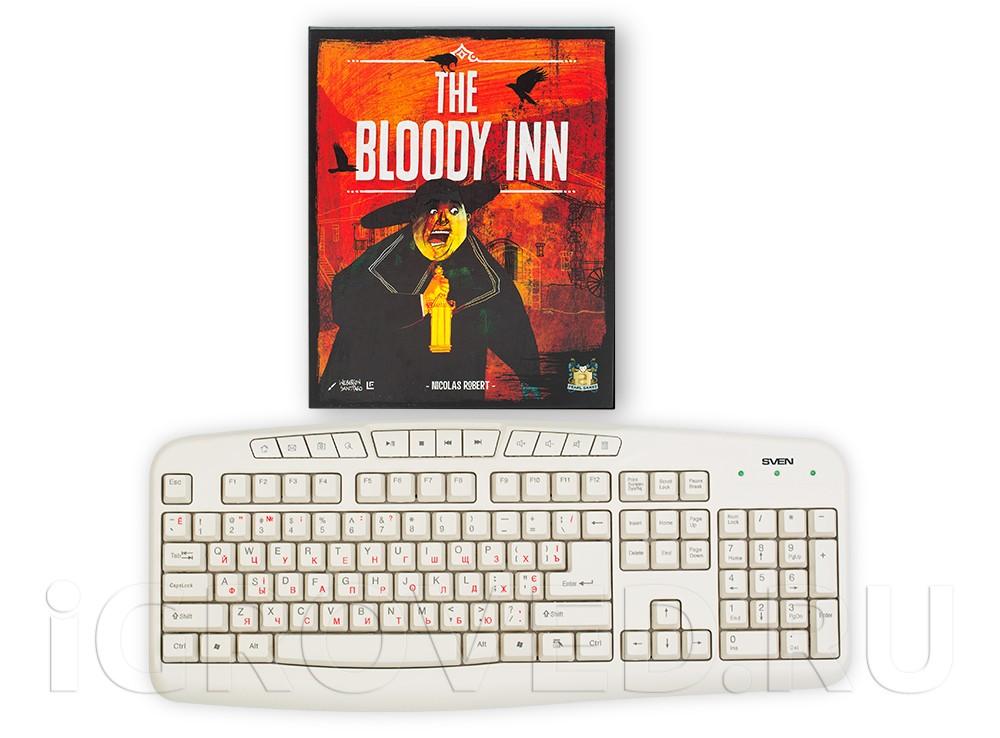 Коробка настольной игры Кровавая таверна (The Bloody Inn) в сравнении с клавиатурой