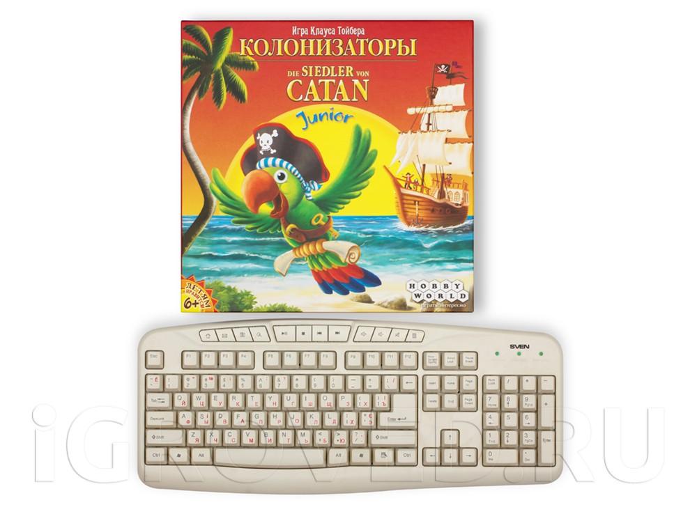 Коробка настольной игры Колонизаторы Junior по сравнению с клавиатурой