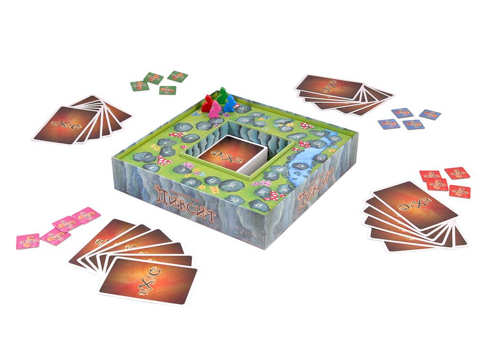 Каждый игрок берет 6 карт и жетоны голосования своего цвета. Настольная игра Диксит (Dixit)