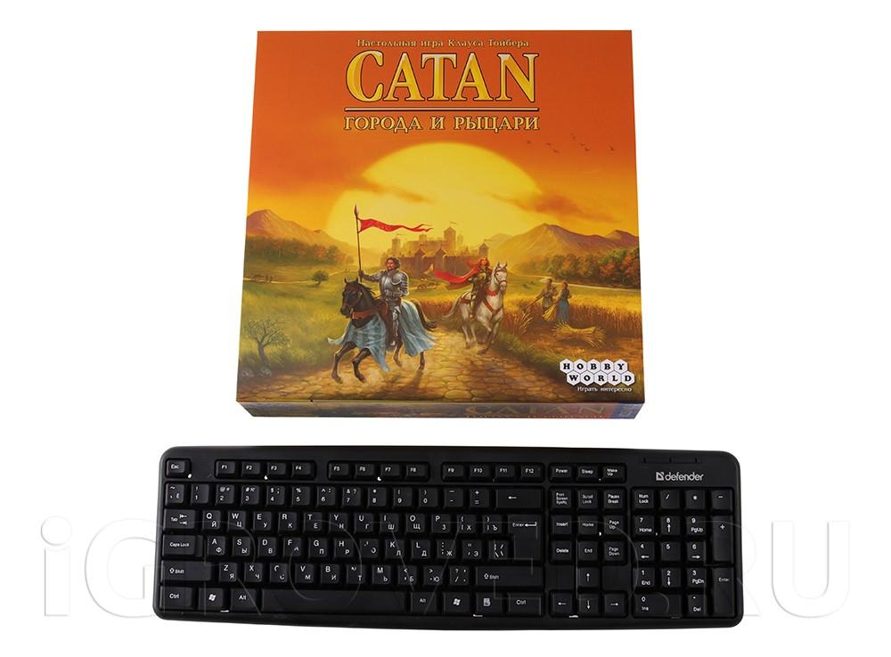 Коробка настольной игры Колонизаторы: Города и рыцари в сравнении с клавиатурой