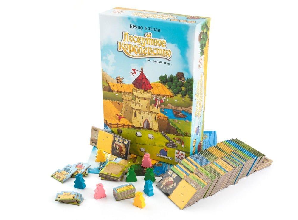 Коробка настольной игры Лоскутное королевство в сравнении с клавиатурой