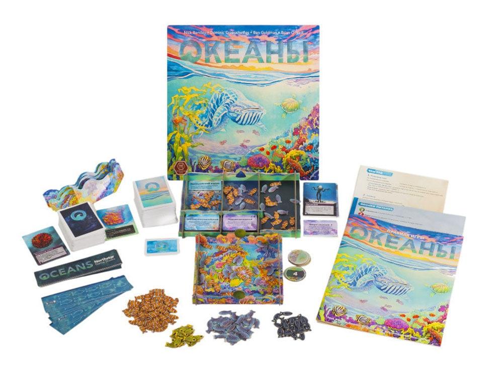 Коробка и компоненты настольной игры Океаны