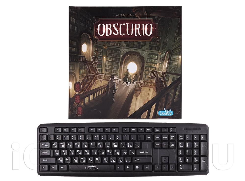 Коробка настольной игры Обскурио (Obscurio) в сравнении с клавиатурой