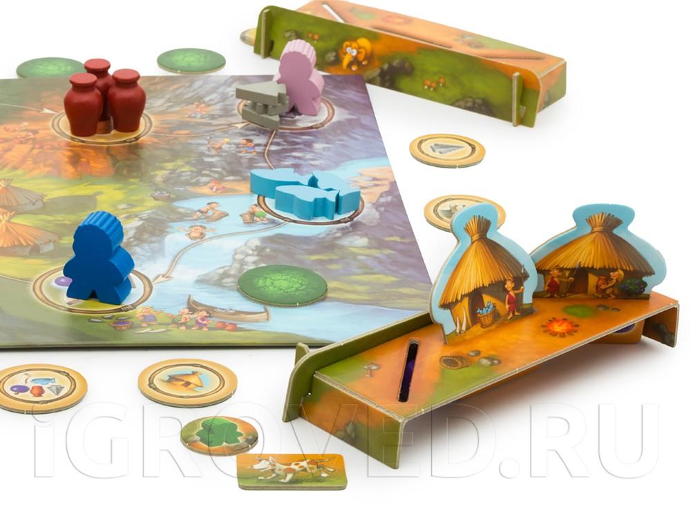 Фишки игроков двигаются по полю в поисках ресурсов. Настольная игра Каменный век Junior (My first Stone Age)