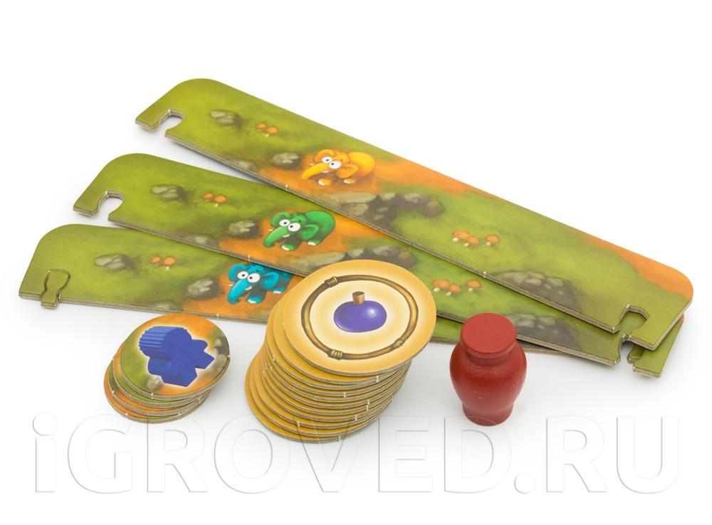 Каждый ход игроки открывают один из жетонов, разложенных вокруг поля. Настольная игра Каменный век Junior (My first Stone Age)