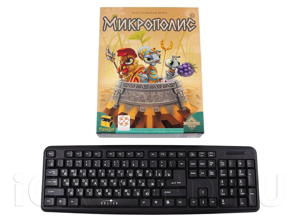 Коробка настольной игры Микрополис в сравнении с клавиатурой