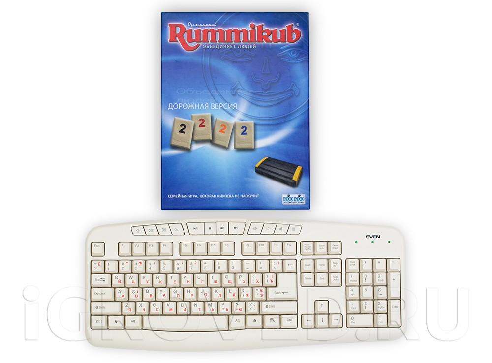 Коробка настольной игры Руммикуб (дорожная версия) в сравнении с клавиатурой