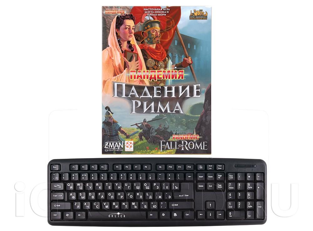Коробка настольной игры Пандемия: Падение Рима (Pandemic. Fall of Rome) в сравнении с клавиатурой