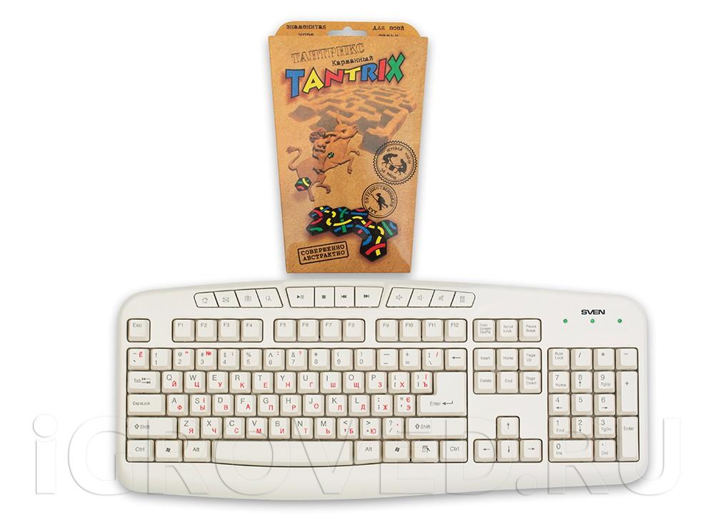 Коробка настольной игры Тантрикс (карманный) по сравнению с клавиатурой