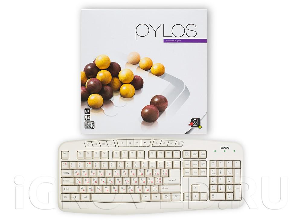 Коробка настольной игры Пилос (Pylos) в сравнении с клавиатурой