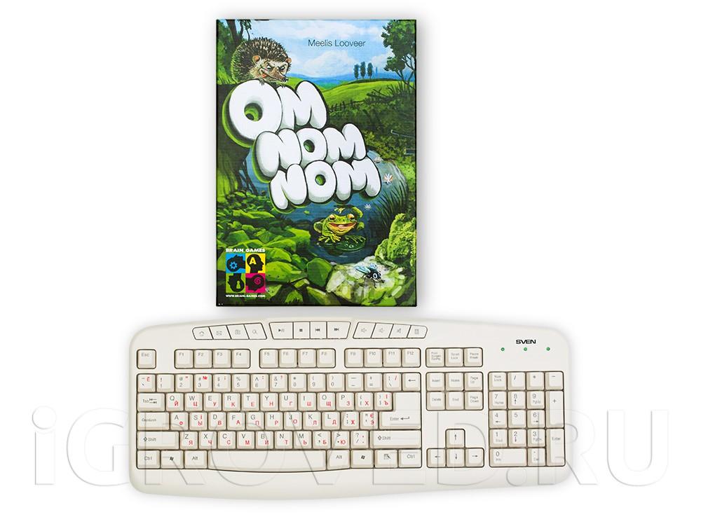 Коробка настольной игры Ом ном ном (Om Nom Nom) в сравнении с клавиатурой